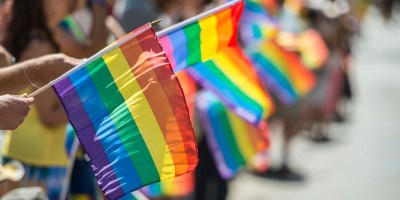 Photo of crowds waving Pride flags