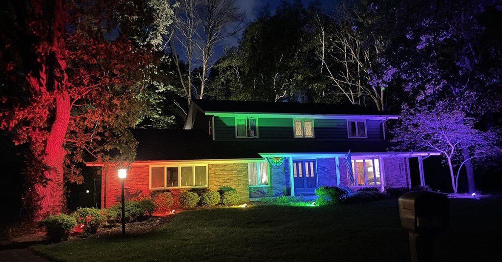 A house bathed in rainbow lights in celebration of Pride Month