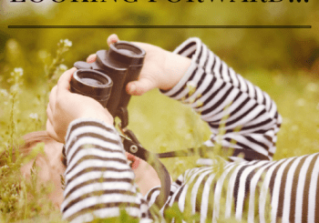 image of boy looking through binoculars for looking forward blog post