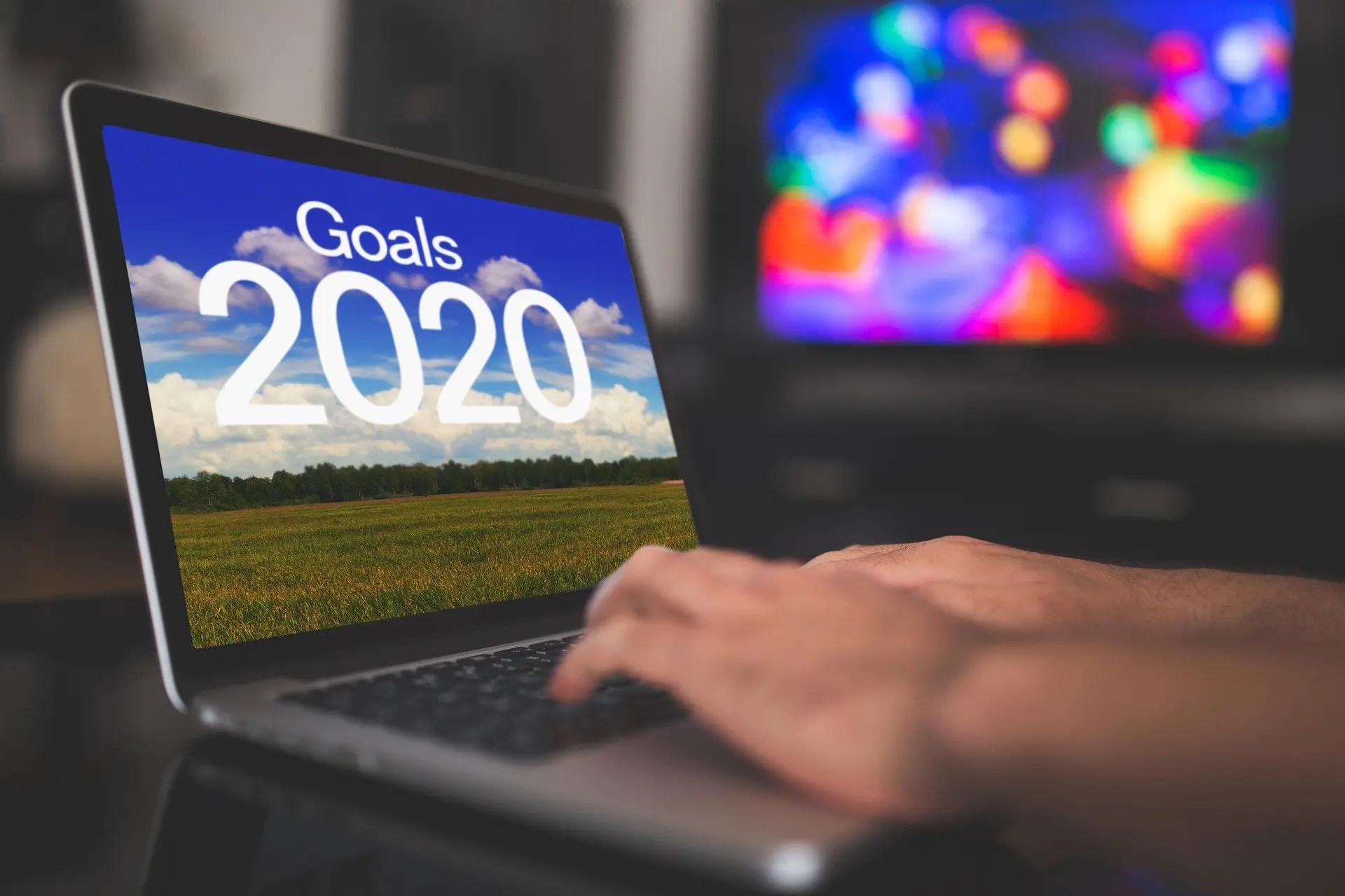 """Image of person typing on a laptop with"""" Goals 2020"""" on the screen"""