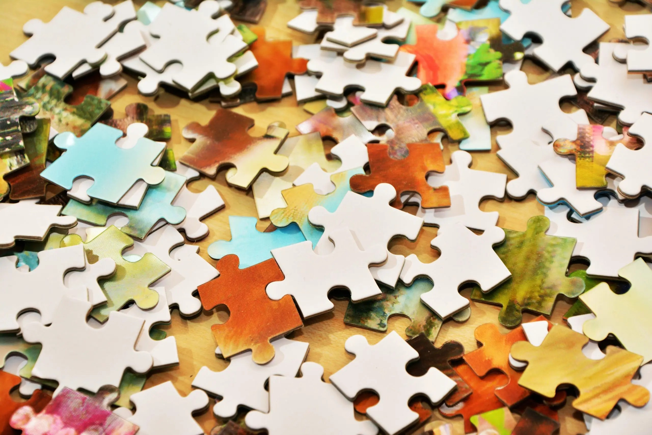 Image of a pile of puzzle pieces symbolizing touch problems