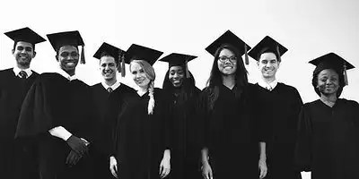 Black and white image of a diverse group of eight college graduates in caps/gowns. We want to look at ALL students, not just first-time full-time.