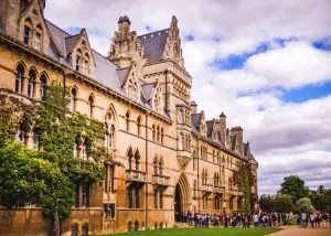 Private college Gothic style building with students in front - could they be part of the fall enrollment for 2020?