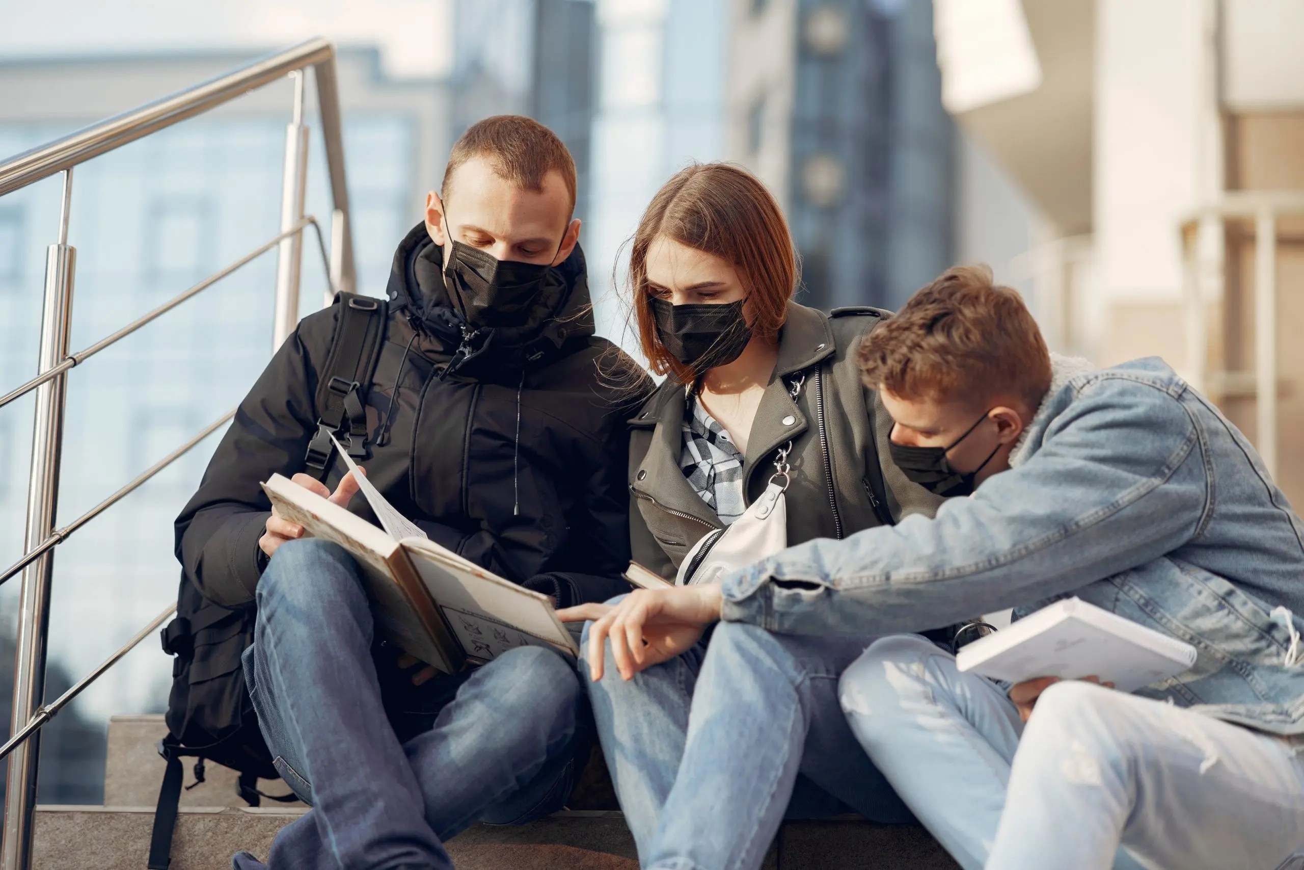 Students in face masks reading books during COVID 19