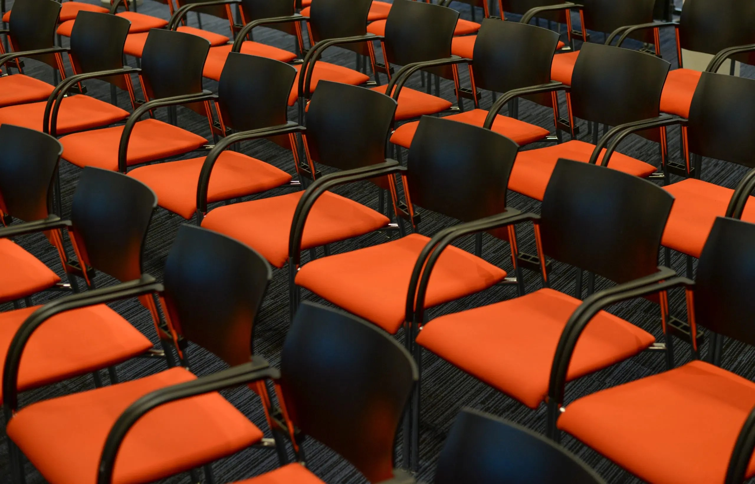 Empty orange conference chairs in rows