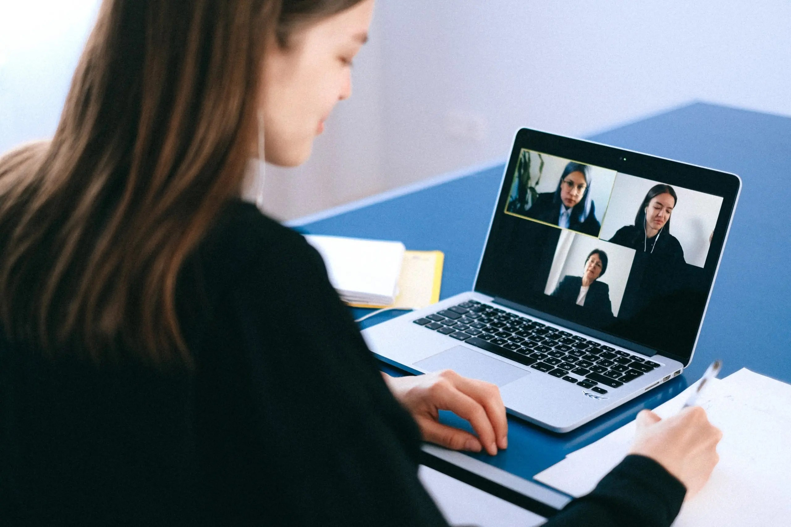 People participating in a converence by video