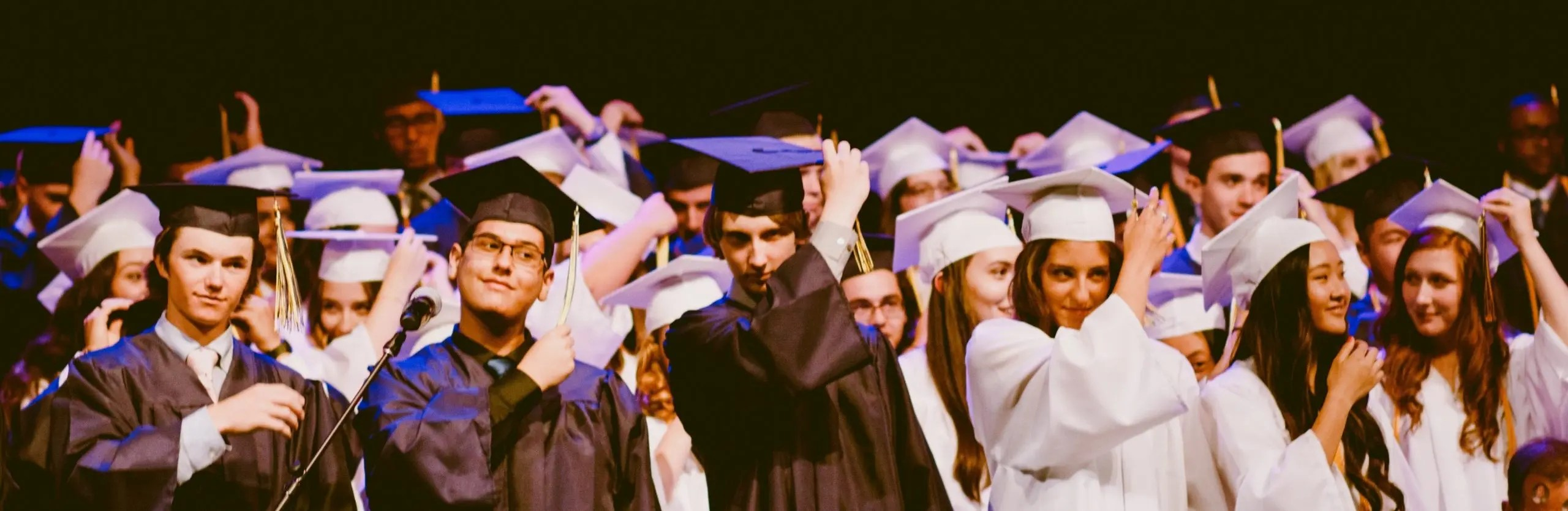 Graduates Moving the Tassels from their Hats