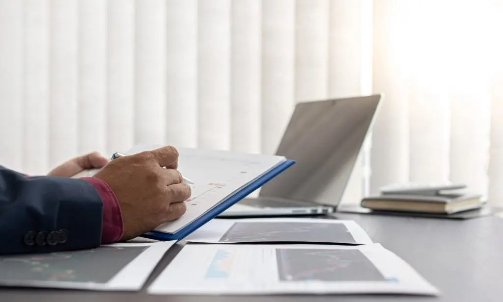 Man reviewing reports in an office