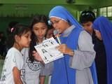 Enseñando a rezar el Rosario