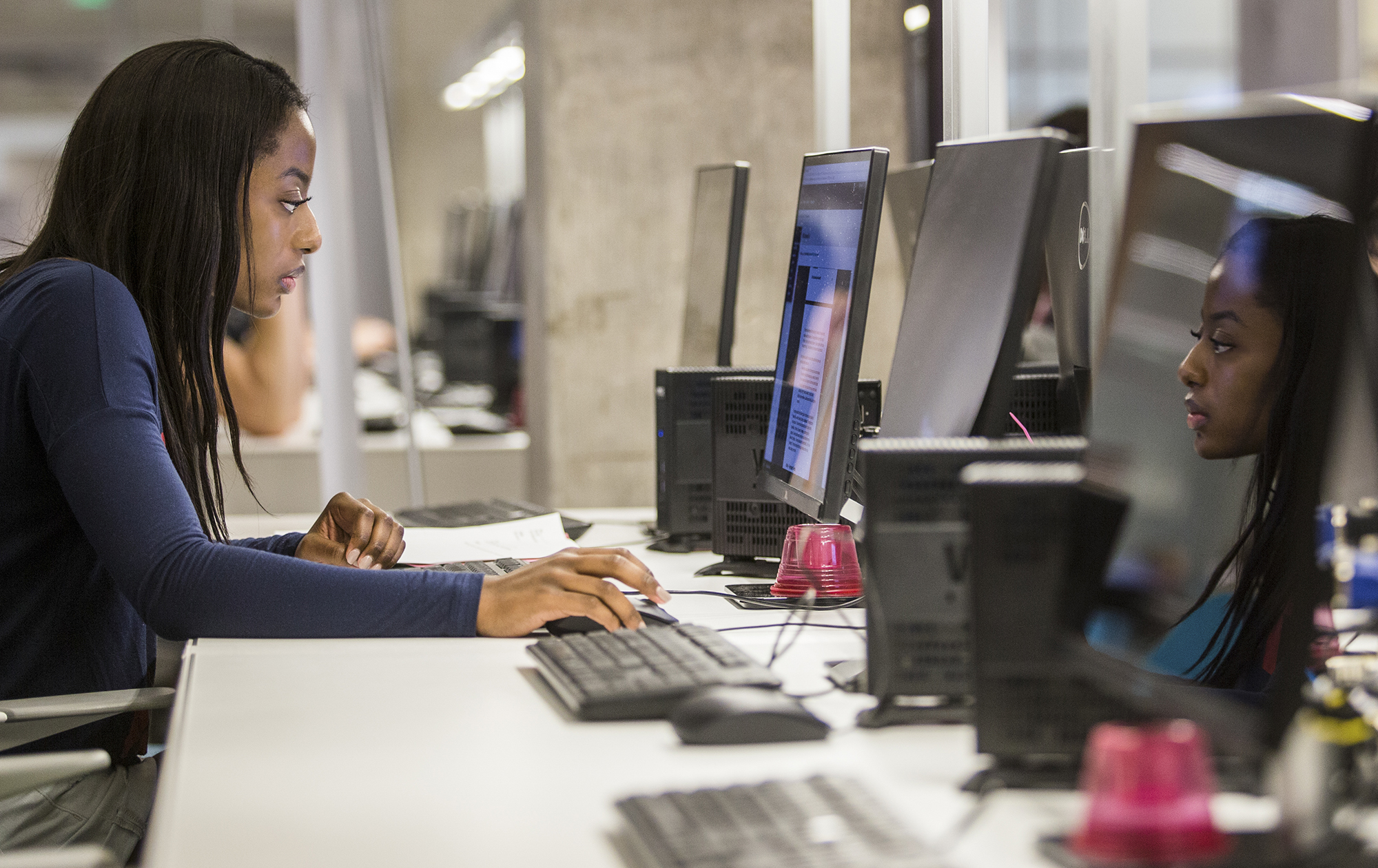 A student studies on her computer