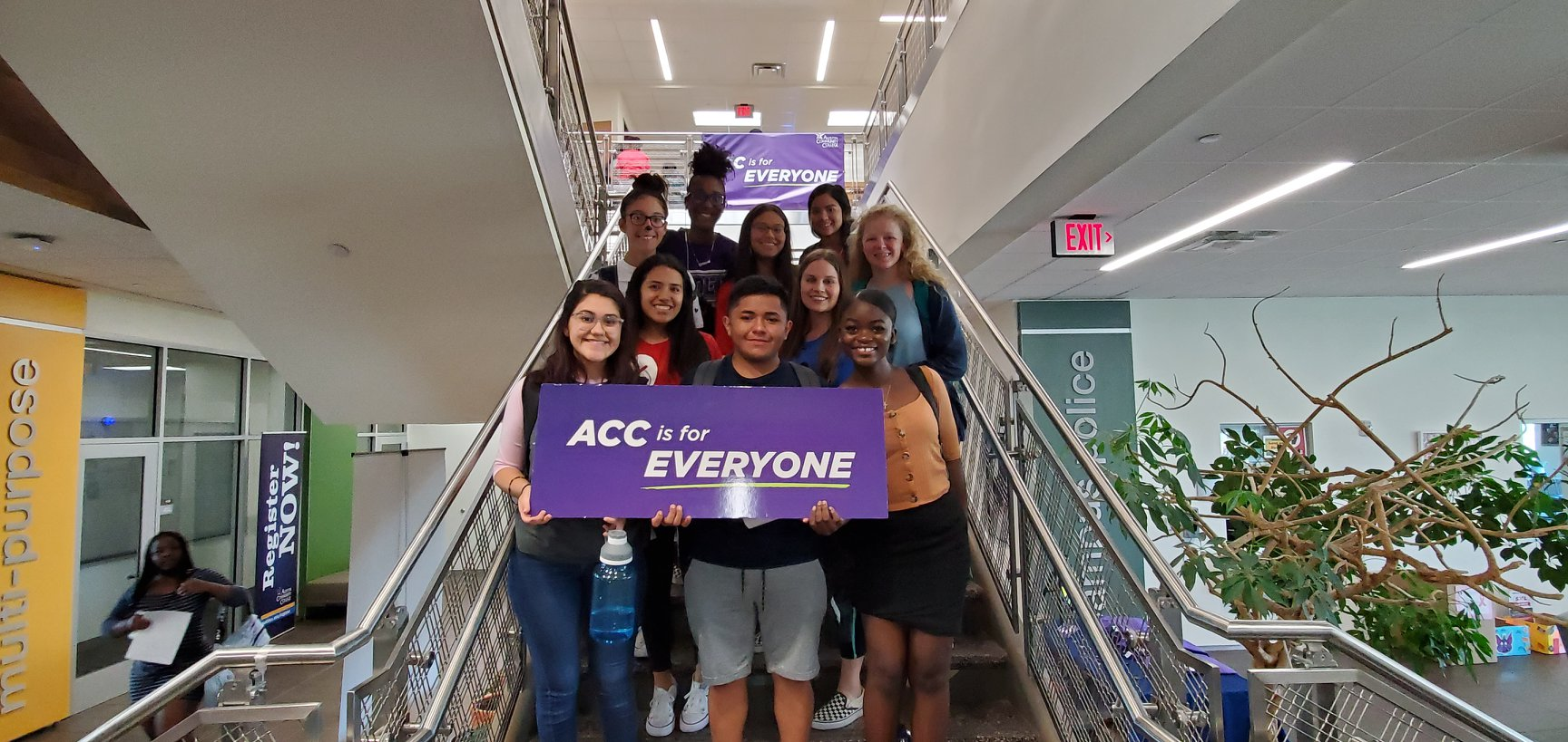 students holding acc is for everyone sign
