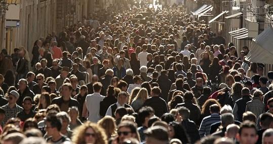 Crowd of people walking in city.