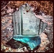 Found, broken square bottle of light green glass. Age?
