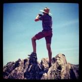 Walker, triumphant, after climbing Obsidian Dome.