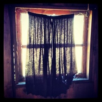 Window curtain of old movie set S. American River Trail
