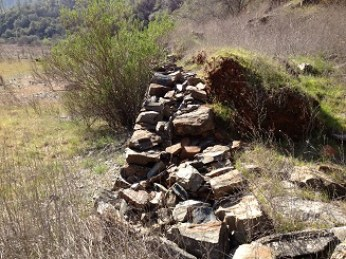 Hand built rock wall to support North Fork Ditch water canal 19th century.