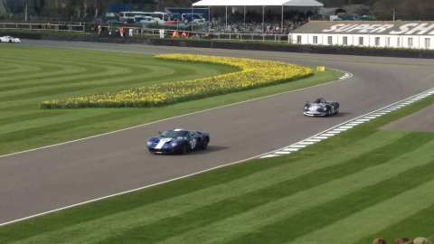 Ford GT40 followed by a Lotus Type 40