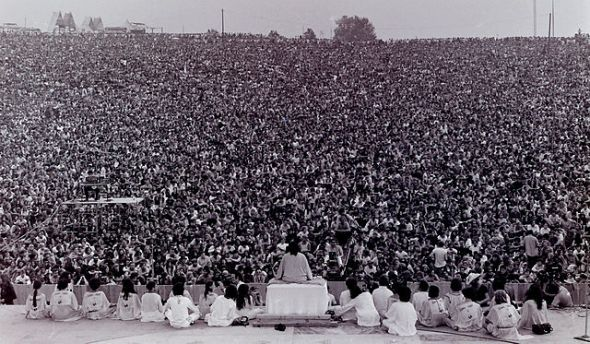 "Swami Satchidananda opening the 1969 Woodstock festival with the chanting of ""Om""."