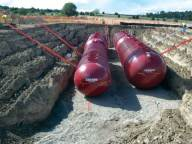 Fiberglass treatment tanks being set