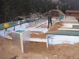 Wastewater treatment pods with protective insulation