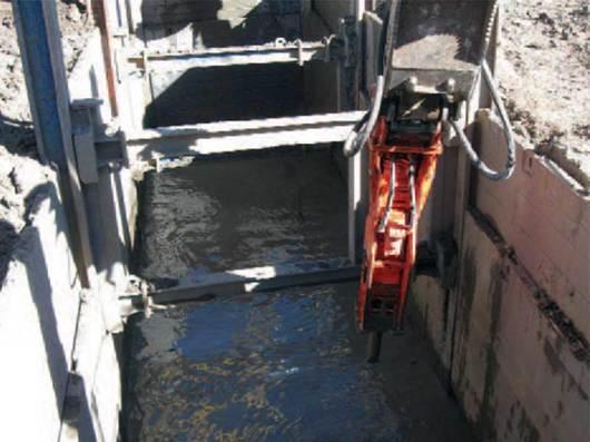 Jackhammer breaking up bedrock for wastewater system