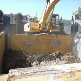 Installing Slide Rail Shoring to protect structures and personnel