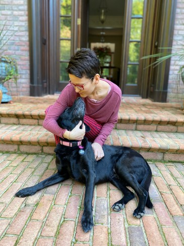 Dr. Ginger Garner with her rescue pup, Scout, who provides the only other feminine presence in a household full of boys. Ginger is pictured here hours after her lumpectomy.