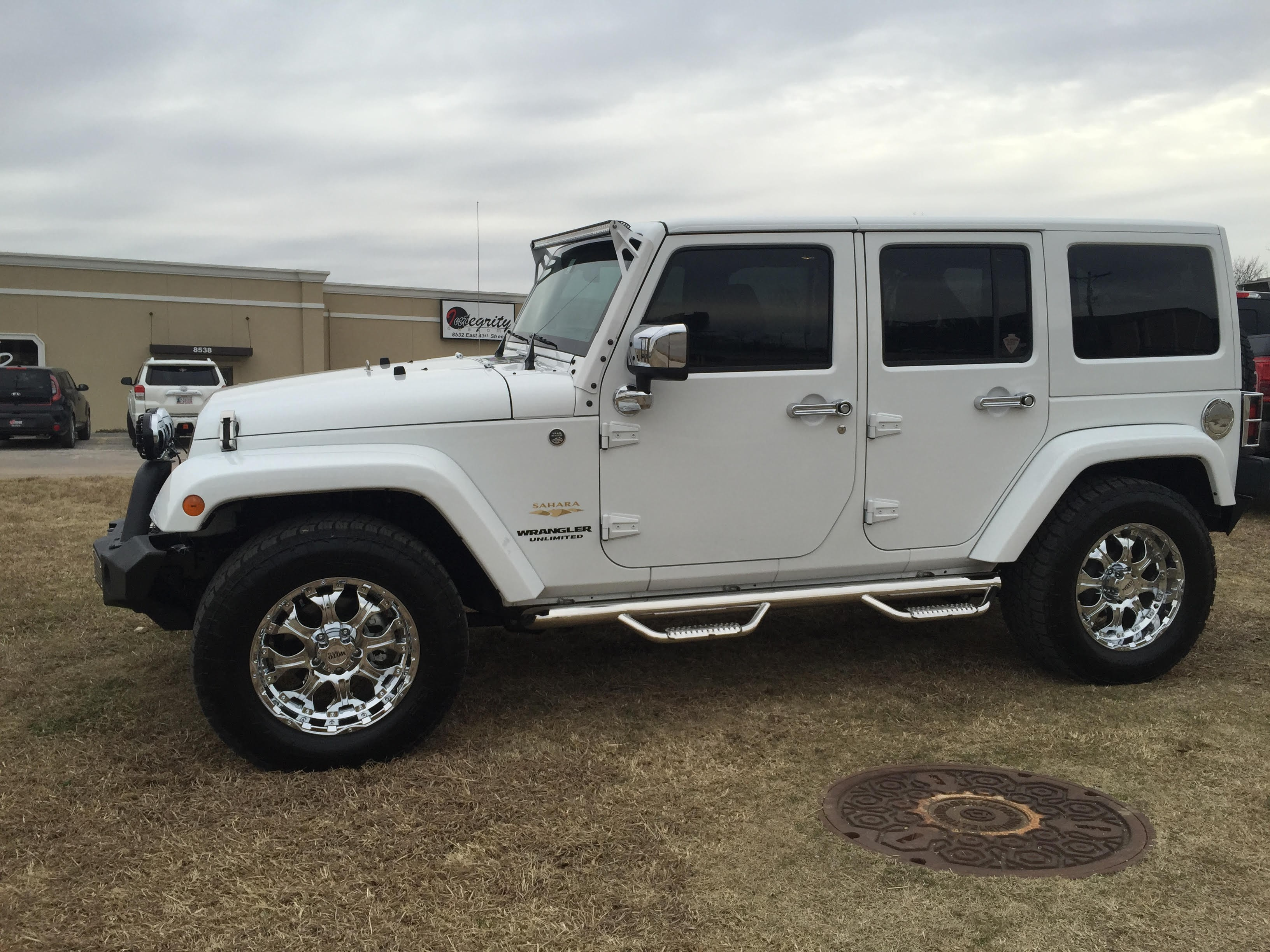 White Jeep with Chrome  Integrity Customs