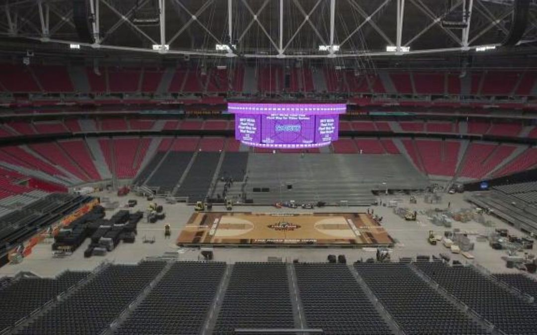 Piece by piece, the court for the NCAA Final Four tournament is put together in Glendale