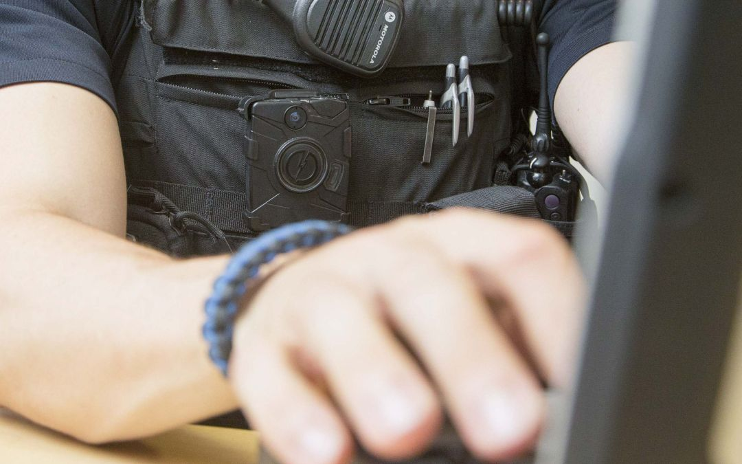 Taser offers free body cameras to police, changes name to Axon