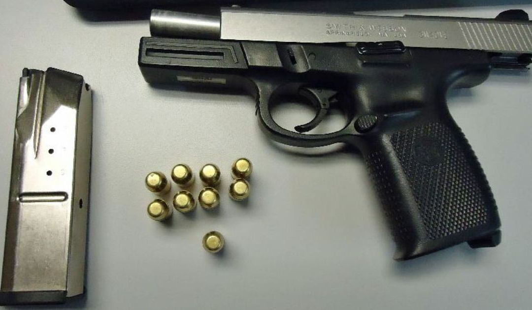 Man caught trying to cross into Mexico with gun