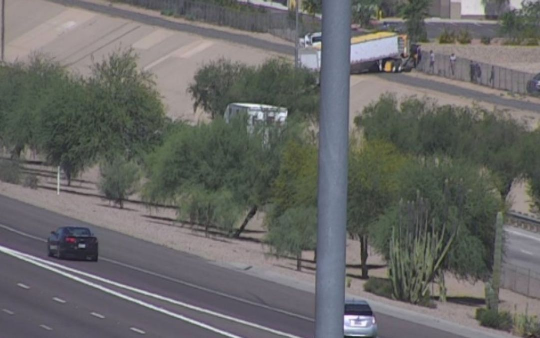 Semitruck load dangles off I-10 embankment near Avondale