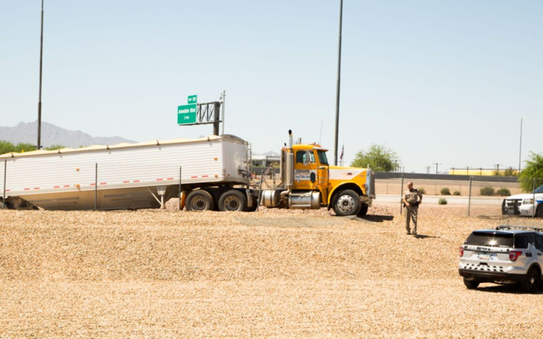 Truck dangles off I-10 embankment