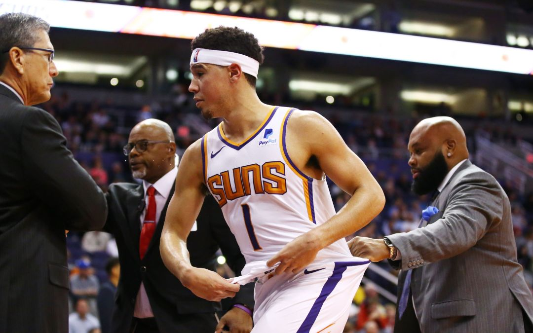 Devin Booker loses control, tries to confront Gorgui Dieng in tunnel