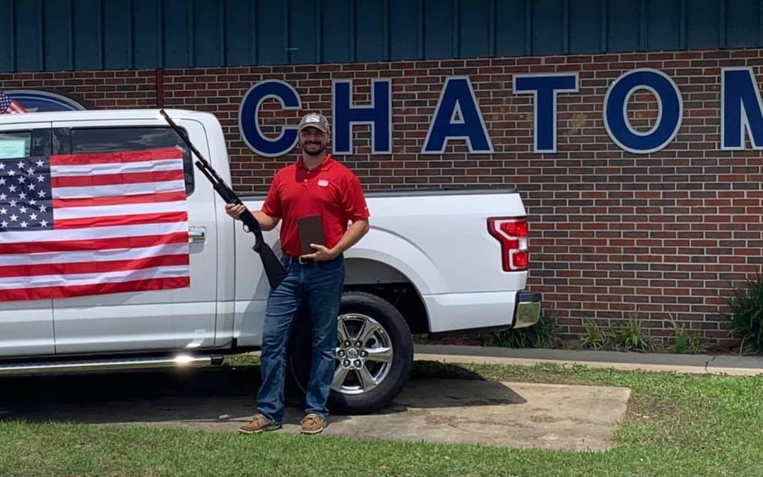 Alabama car dealership includes Bible, shotgun, US flag with purchase