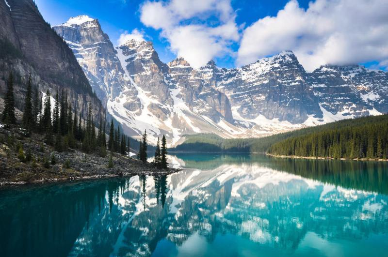 Beautiful white topped mountains overlooking Moraine Lake in the Rocky Mountains