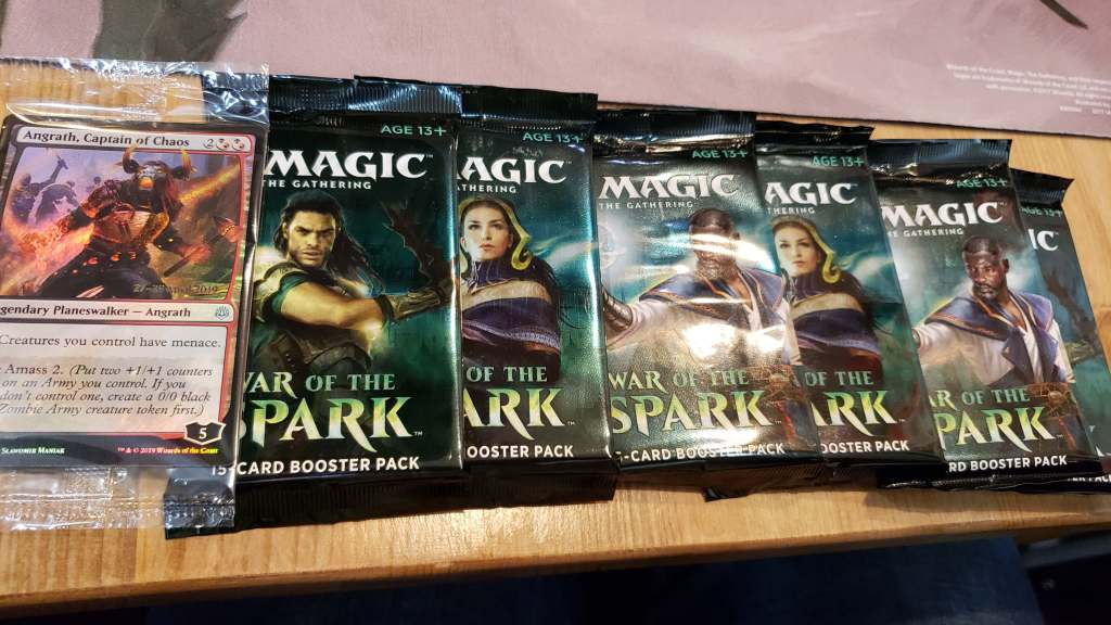A spread of booster packs and limited-edition cards for deck creation.