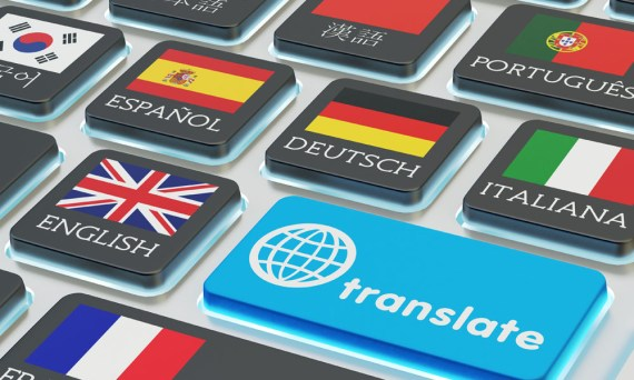 Macro view of computer keyboard with national flags of world countries on keys and blue translate button