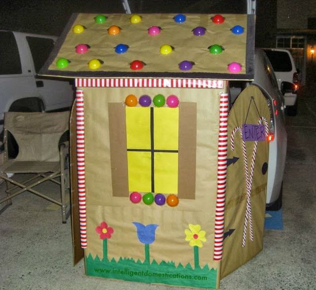 This fun Trunk or Treat Candy Cottage is made using a big box. We used it for our Church Trunk or Treat event a few years ago. The tutorial includes pictures of the process. #Trunkortreat #Churchtrunkortreat