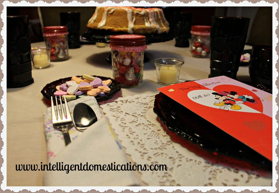 Easy Valentines Tablescape using what I had on hand to decorate the table. Repurpose old Valentines cards as conversation pieces. Mason jar candy treats for everyone. Cake as a centerpiece.
