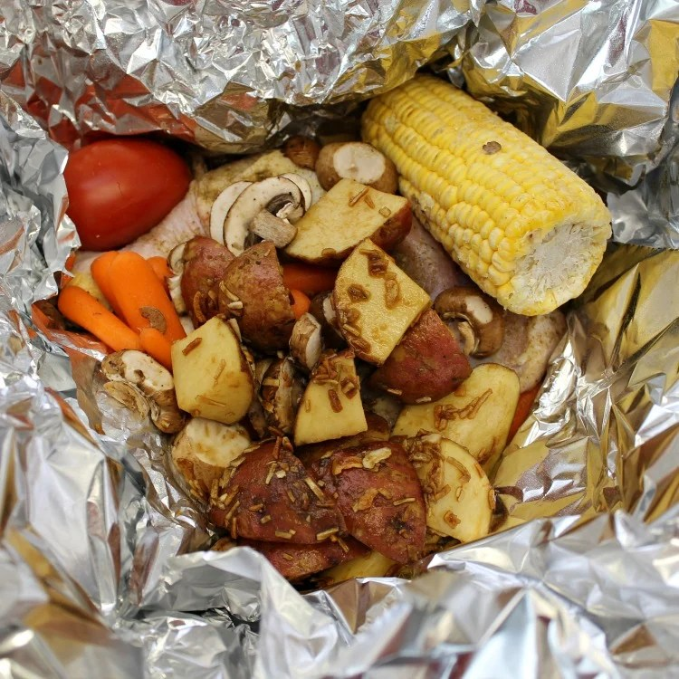 How to make a Foil Pack Chicken Dinner at home. Our Foil packet Chicken Dinner recipe was inspired by Cracker Barrel. You can make this easy dinner recipes in the oven at home or on the grill at home or camping. #foilpack #foilpacketmeal #Chickenrecipe #campingfood