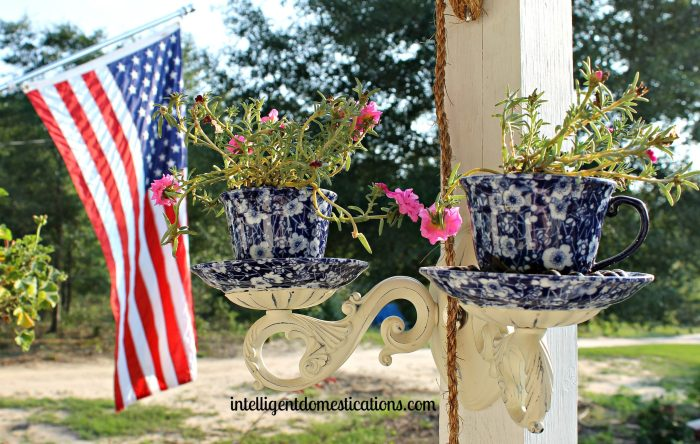 DIY Tea Cup Sconce Planter. It's an easy upcycle project using glue and some pretty things for your porch.