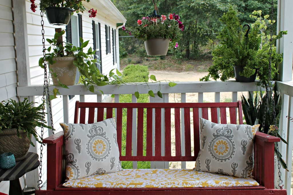 3.I dressed up the porch swing with new pillows and cushion which I made myself.intelligentdomestications.com