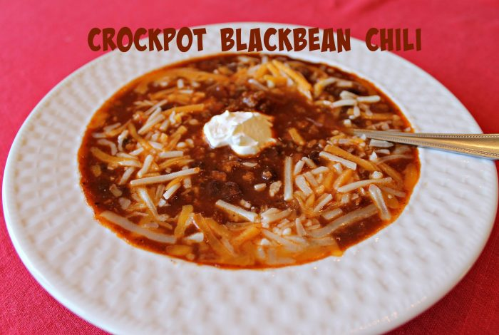 Enjoy a bowl of Crockpot Black Bean Chili topped with shredded cheese and sour cream. Recipe at www.intelligentdomestications.com