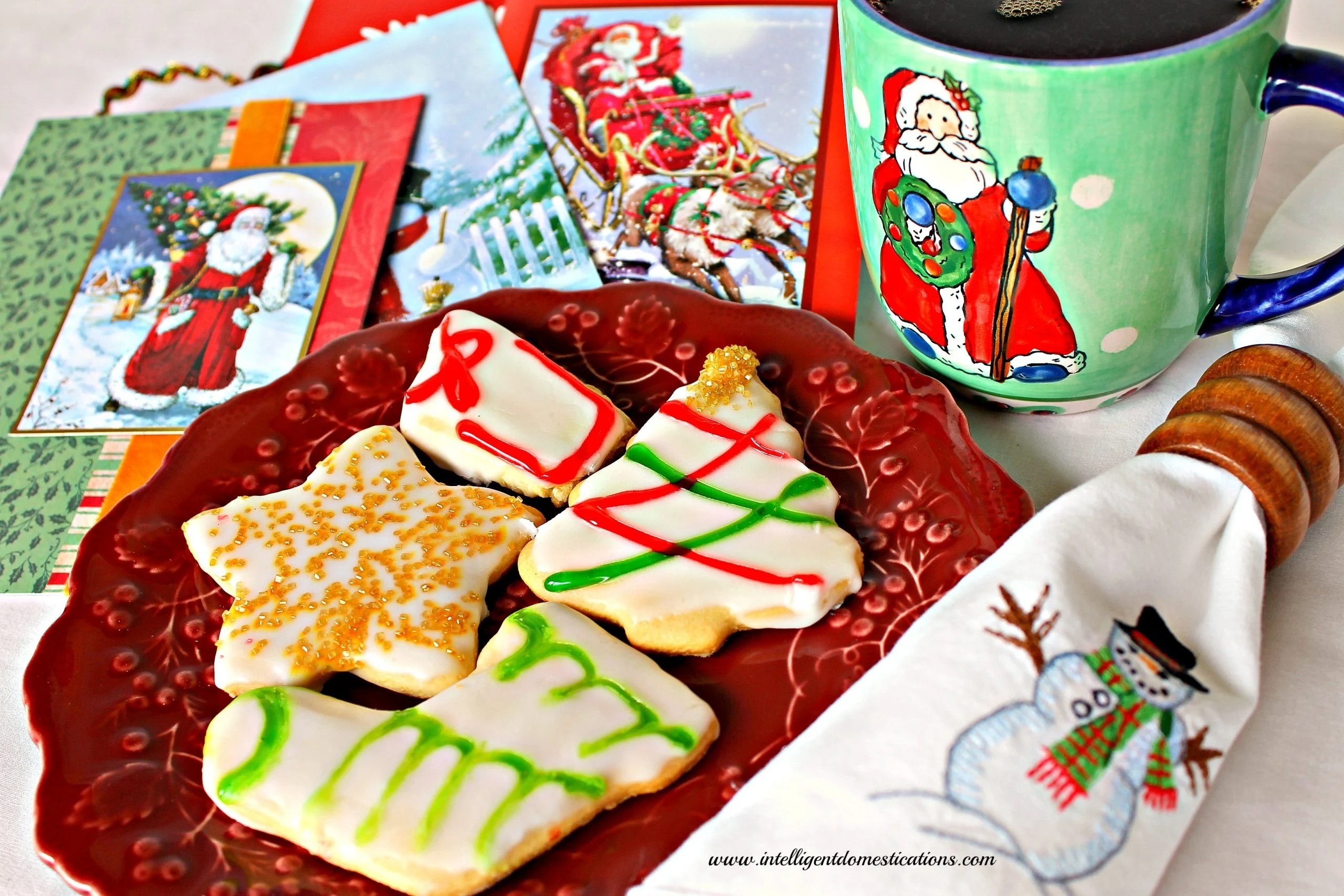 what could be better than a plate of freshly decorated christmas cookies a stack of christmas cards to read and a nice hot cup of coffee