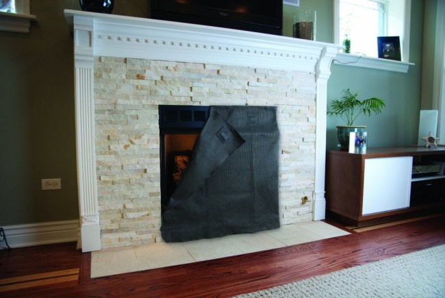 Fireplace blocker blanket on a stone fireplace