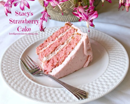 A slice of Strawberry Cake on a plate. Strawberry Cake with Strawberry Icing recipe