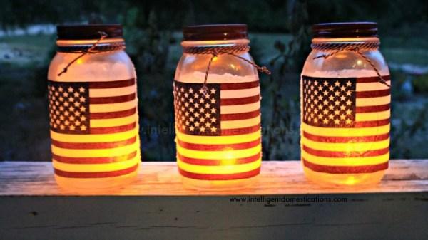 DIY Patrioric Mason Jar Luminaries. Patriotic Mason Jar craft project. How to make Patriotic Mason Jar Candle holders. #patrioticmasonjar #masonjarcraft #patrioticoutdoordecor #diypatrioticdecor #modpodgemasonjarproject