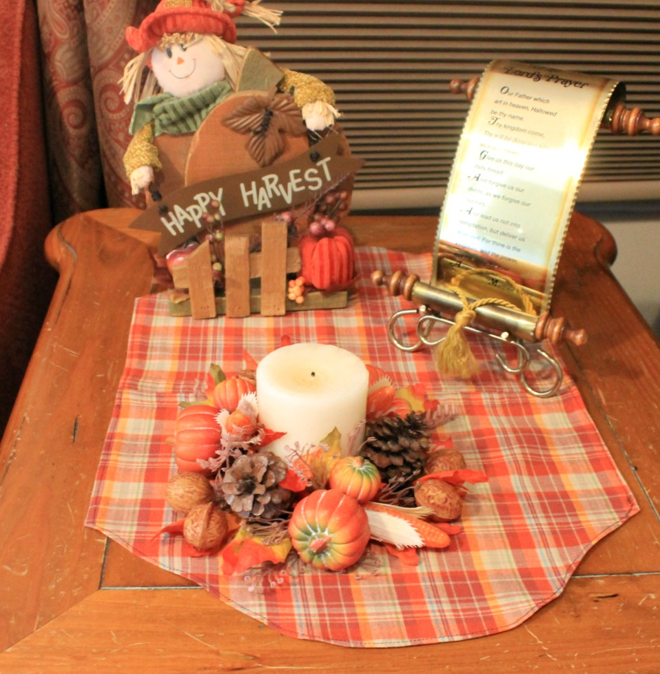 photo of a plaid placemat on an end table with Fall decor
