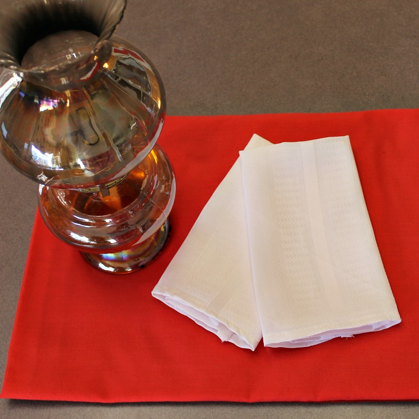 Use what you have.Oil lamp, red tablecloth & cloth napkins create mangia.intelligentdomestications.com